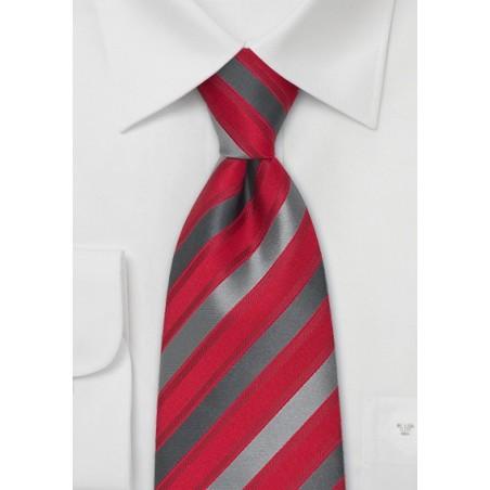 Silk tie, grey diagonal stripes on red fond