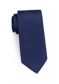 ribbed textured navy blue mens necktie
