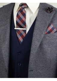 Matching burgundy plaid necktie and pocket square