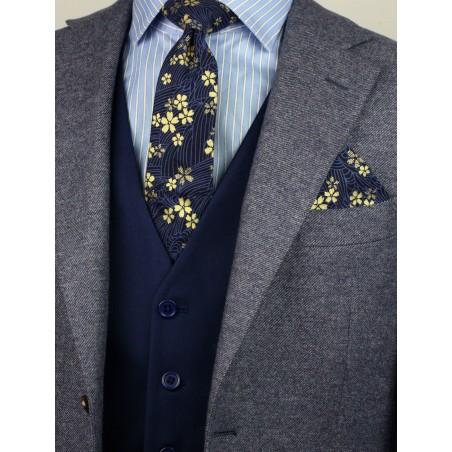 navy and metallic gold slim cut mens necktie with flower designs