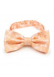 Peach paisley pre-tied bow tie