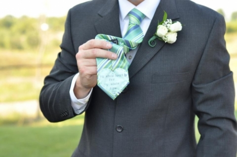 An elegant combination of mint colored tie (style SB1504), gray pin